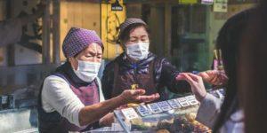 two-vendors-accommodating-customer
