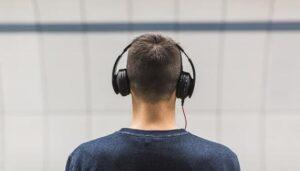 selective-focus-photo-of-man-wearing-black-headphones