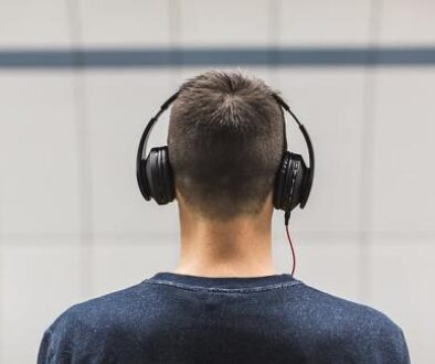 selective-focus-photo-of-man-wearing-black-headphones