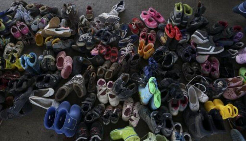 children_shoes_refugees_crisis_Budapest_September_2015_crop
